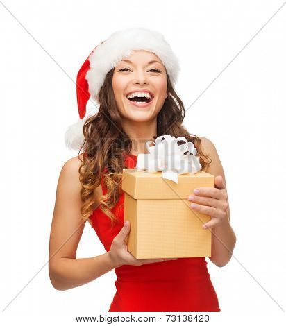 christmas, xmas, winter, happiness concept - smiling woman in santa helper hat with gift box