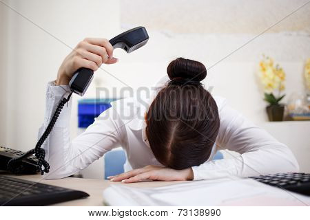 Young attractive business woman with phone in hand
