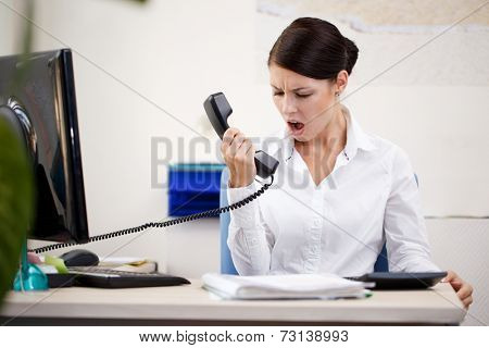 Angry woman shouting at phone