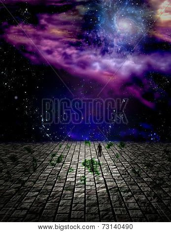 Man in surreal landscape before the heavens Elements of this image furnished by NASA