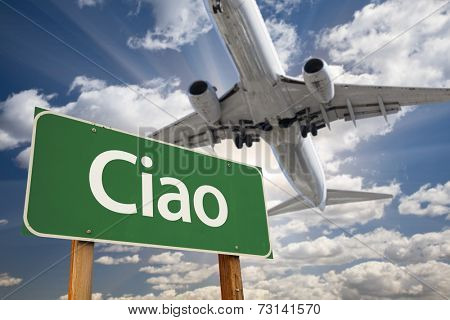 Ciao Green Road Sign and Airplane Above with Dramatic Blue Sky and Clouds.
