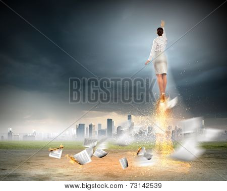 Businesswoman on lead trying to fly away