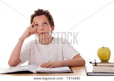 Boy Studying And Thinking, Along With One On Apple Top Of Some Books
