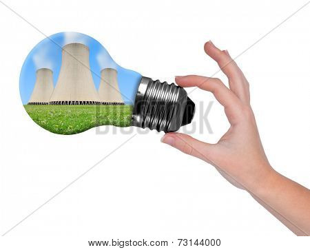 Hand holding bulb with nuclear power plant  isolated on white