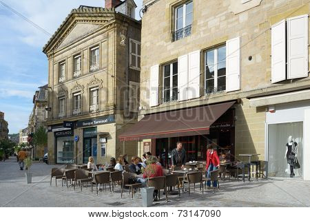 BRIVE-LA-GAILLARDE, FRANCE - SEPTEMBER 9, 2013: People resting in the restaurant La Panetiere on the Charles de Gaulle square. In French popular culture the town is associated to a song by G. Brassens