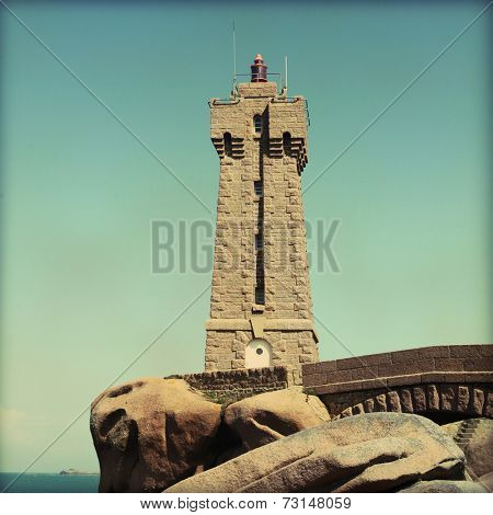 Vintage image of lighthouse on the Pink Granite Coast in Brittany.