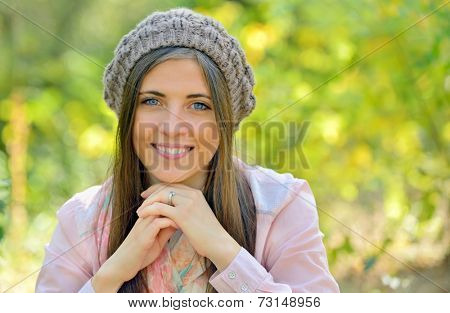 Autumn portrait of young woman in forest