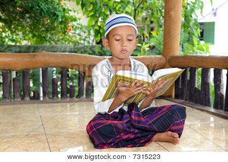 Muslim Child Reading Koran