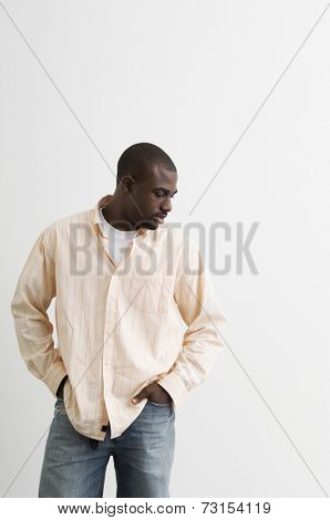 African man with hands in pockets