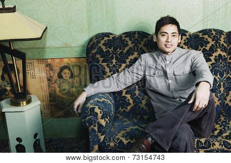 Portrait of Pacific Islander man on sofa
