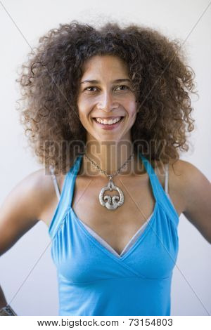 Portrait of African woman with hands on hips