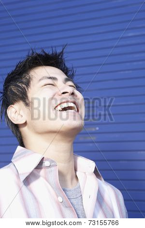 Close up of Pacific Islander man laughing