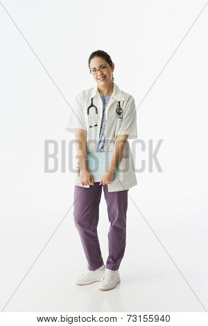 Studio shot of Hispanic female doctor