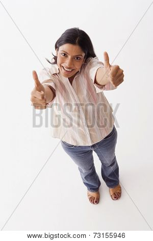 High angle view of Indian woman giving thumbs up