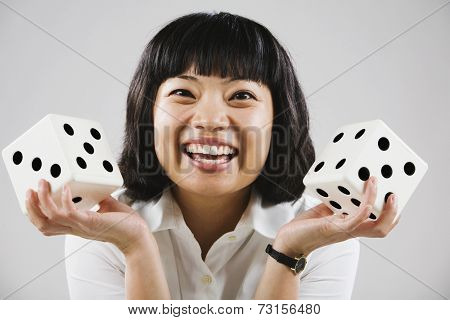 Portrait of Asian woman holding dice