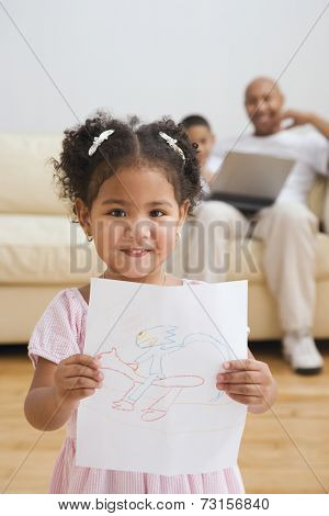 Indian girl holding up drawing