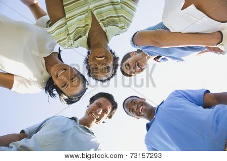 Low angle view of multi-ethnic friends in huddle