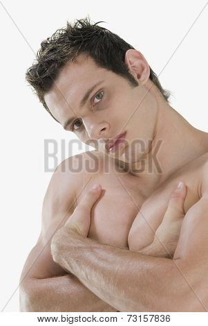Bare-chested man with arms crossed