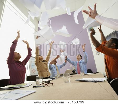 Businesspeople cheering at meeting