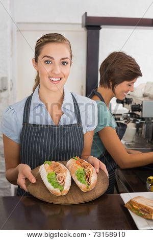 Pretty waitresses working with a smile at the coffee shop
