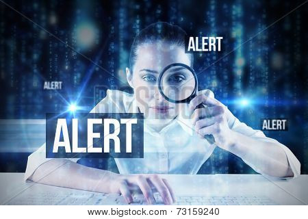 The word alert and businesswoman typing and looking through magnifying glass against lines of blue blurred letters falling