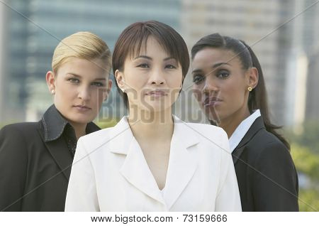 Three multi-ethnic businesswomen outdoors