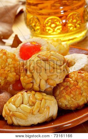 some panellets and a bottle of sweet wine, typical snack in All Saints Day in Catalonia, Spain