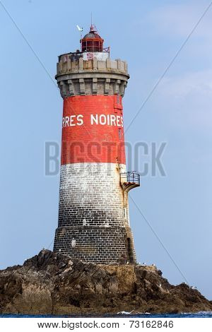 The Pierres Noires lighthouse in full sea, Finistere, Brittany, France