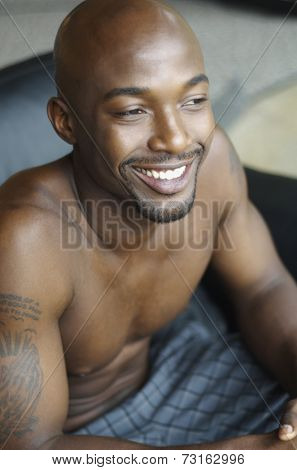 Portrait of bare chested African man