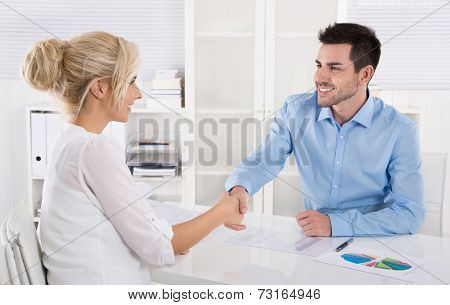 Handshake: Adviser says hello to his female customer.