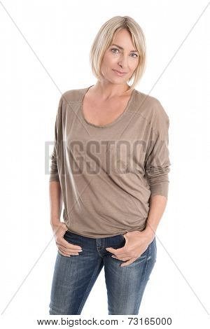 Isolated attractive woman in the forties wearing blue jeans and shirt.