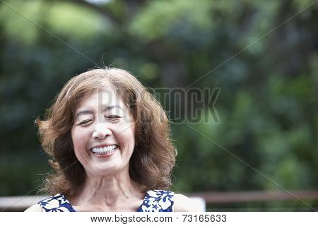 Senior Asian woman laughing
