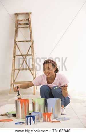 Asian woman with painting supplies