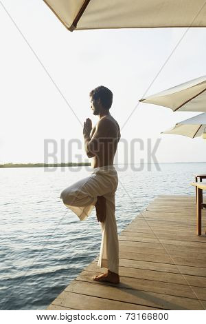 South American man practicing yoga