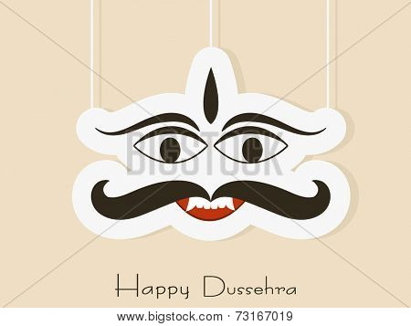 Illustration of hanging Ravana face in white with Happy Dussehra text.