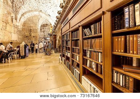 JERUSALEM, ISRAEL - JULY 10, 2014: Wooden shelfs with holy books in Cave Synagogue which is a part of Western Wall (aka Wailing Wall) - Judaism's holy place.