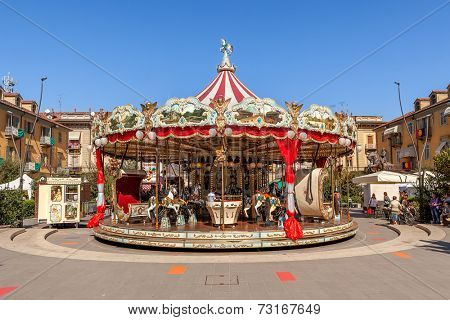 ALBA, ITALY - OCTOBER 02, 2011: Carousel on city square as part of famous annual White Truffle festival and celebrations taking place each year in october in Alba, Italy.