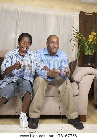 African father and son playing video games