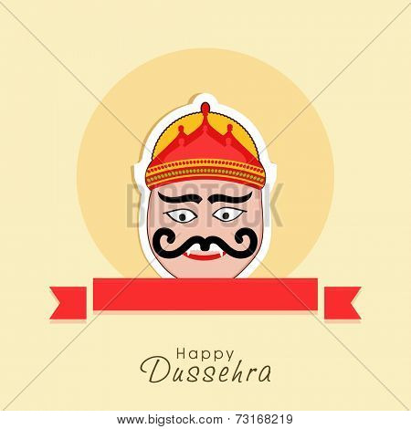 Illustration of Ravana face with big eyes and moustache and with a red label below.