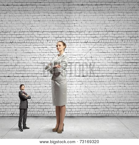 Miniature of young businessman and bossy businesswoman