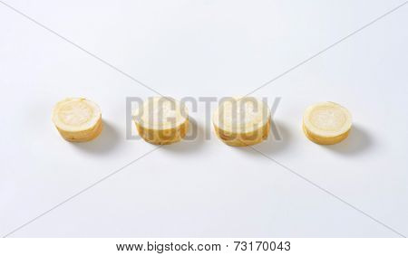 sliced parsley root on white background