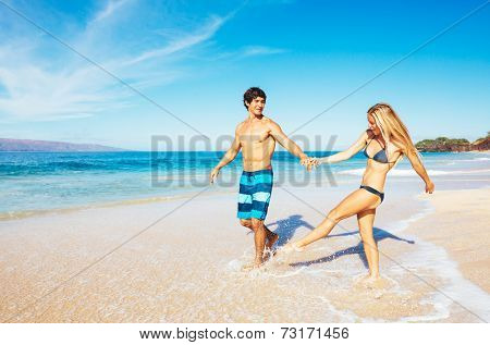Attractive Happy Couple Running and Playing on Beautiful Sunny Beach