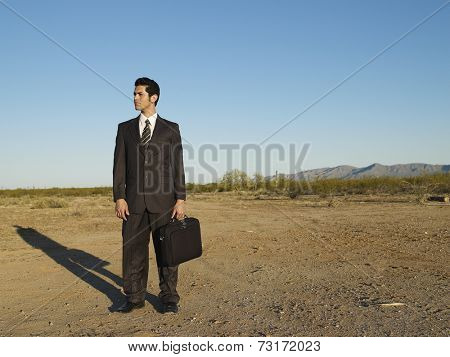 Hispanic businessman in middle of nowhere