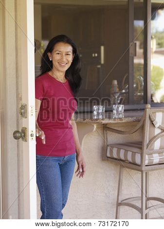Eurasian woman next to door