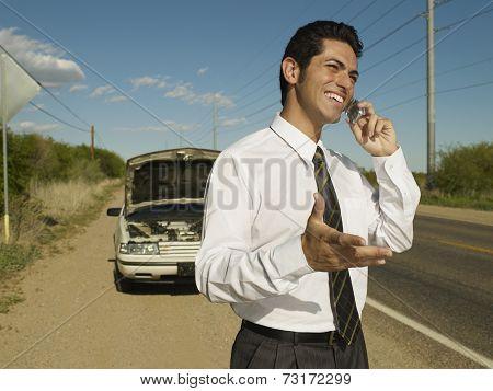 Hispanic man broken down on side of road