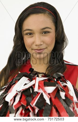 Asian girl holding pom-pom