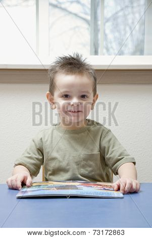 Hispanic boy reading book