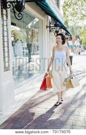 Hispanic woman window shopping