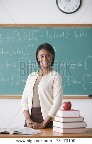 African American female teacher at desk