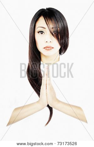Asian woman with hands pressed together
